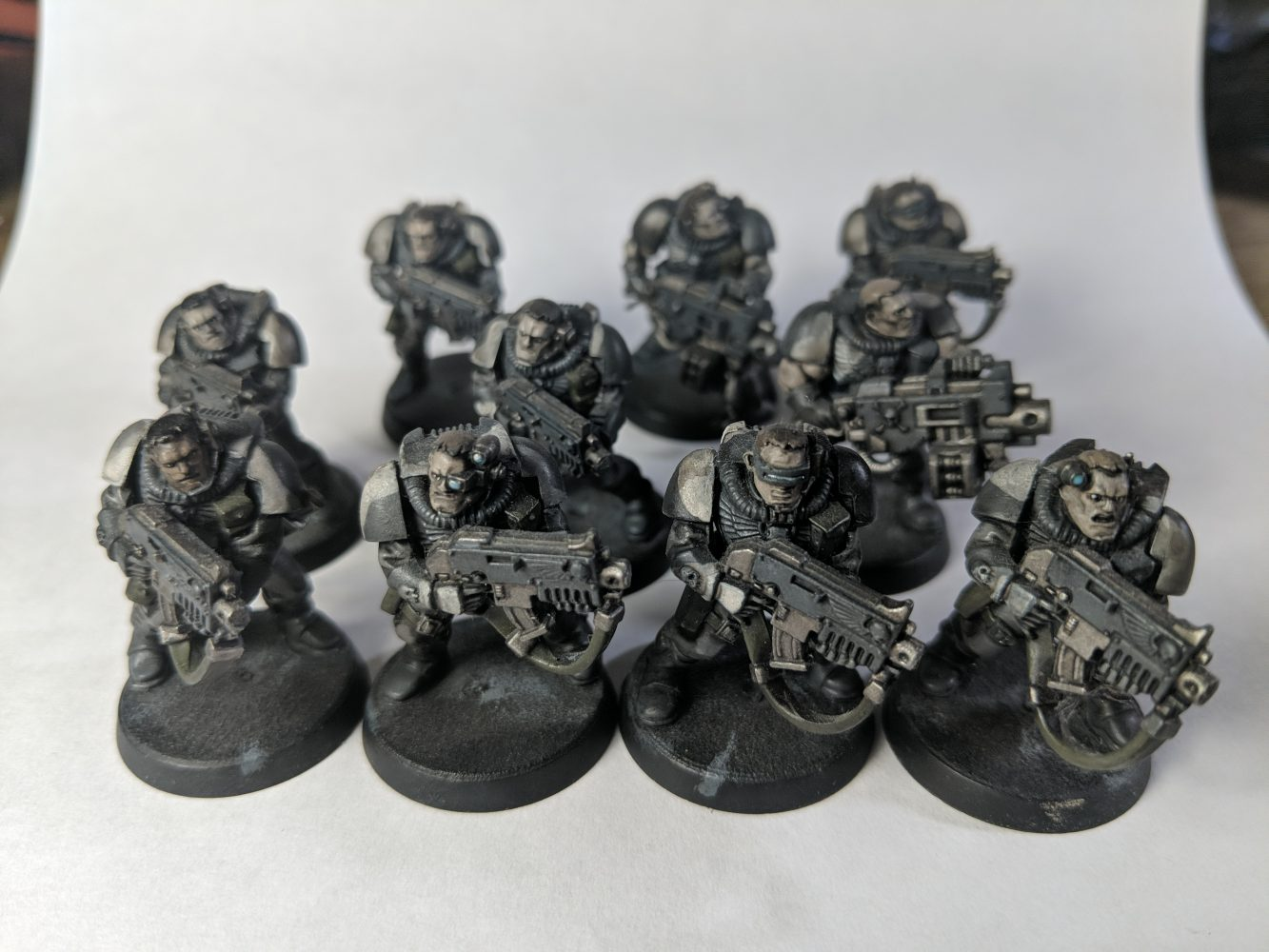 Space Marine scouts in grey and white camo scheme.